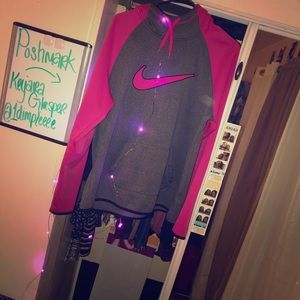 A grey and pink nike hoodie